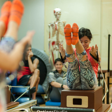 Movement Specialist Jamie on the reformer