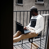 man_working_from_balcony_unsplash.png
