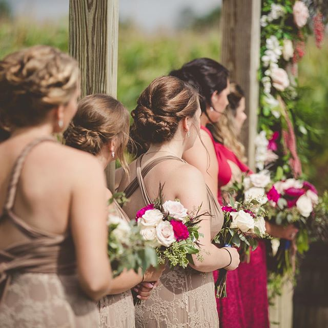 Gorgeous bridesmaids and their beautiful floral bouquets bringing it all together  Photo __josephine