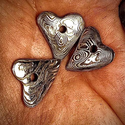 Damascus heart pendants