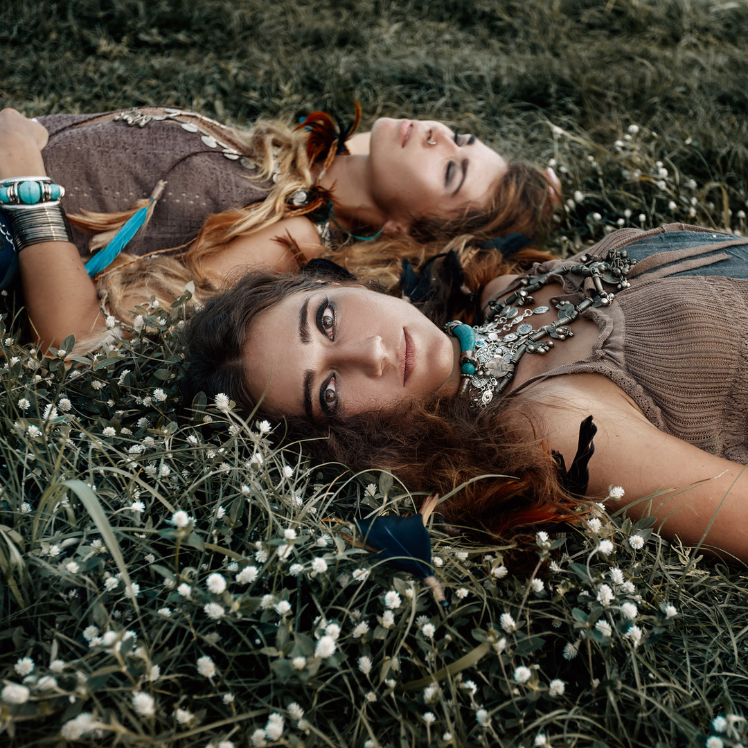 Two beautiful boho girls in ethnic jewel