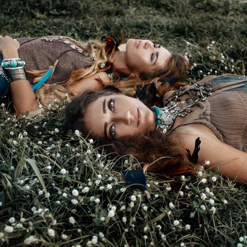 Two beautiful boho girls in ethnic jewel