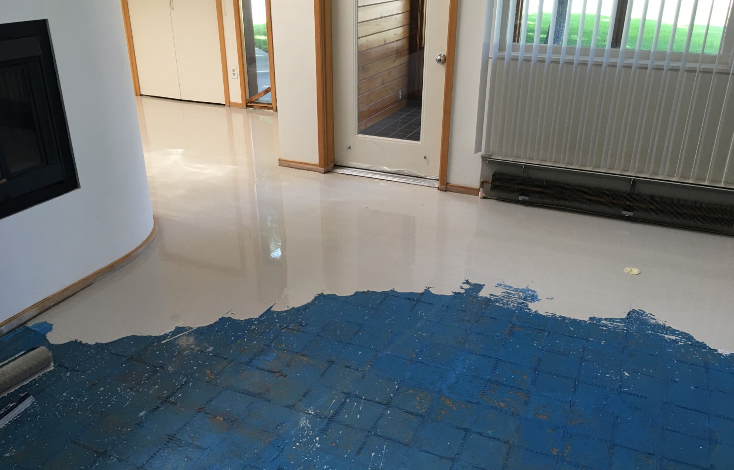 Leveled floor with applied epoxy coating