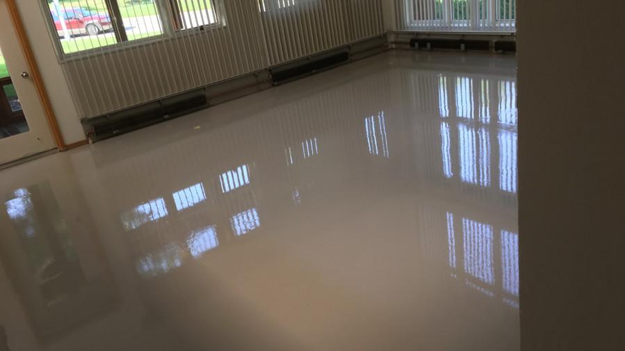 Leveled floor with applied epoxy coating