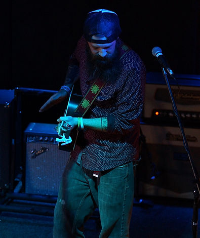 Justin Marshall Orlow with his guitar
