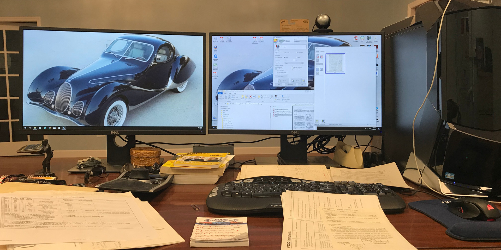 2 monitors, liquid cooled tower, latest Dell laptop, Solidworks.