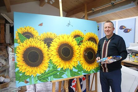 Keith with his Sunflowers painting 'From now on in, it's strictly blue Sky'
