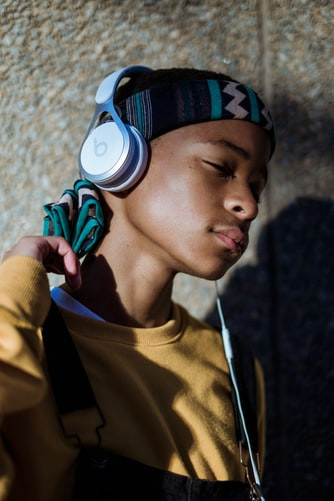 A young boy wearing headphones
