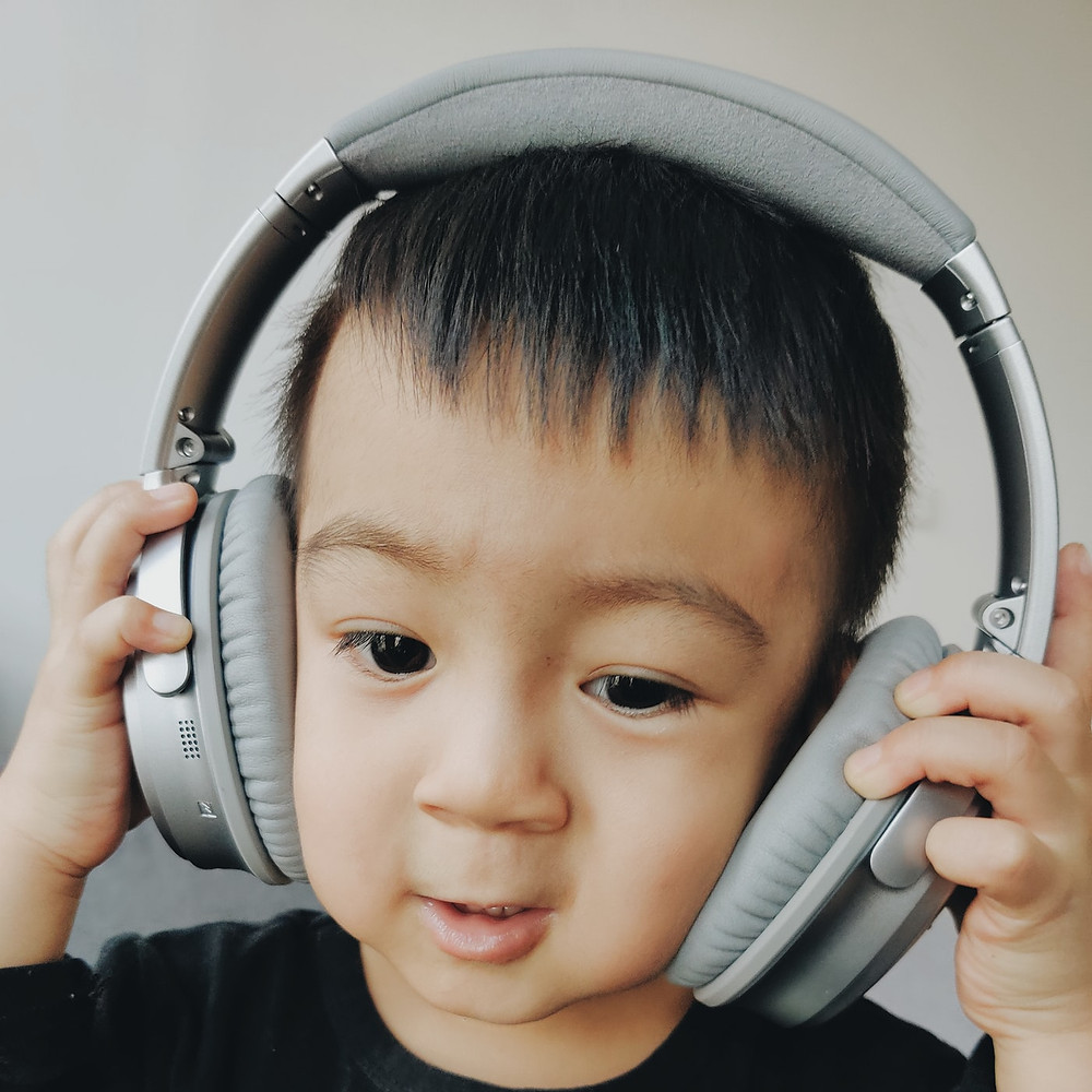 A toddler wearing headphones