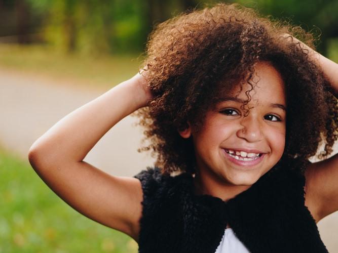 A little girl smiling outside