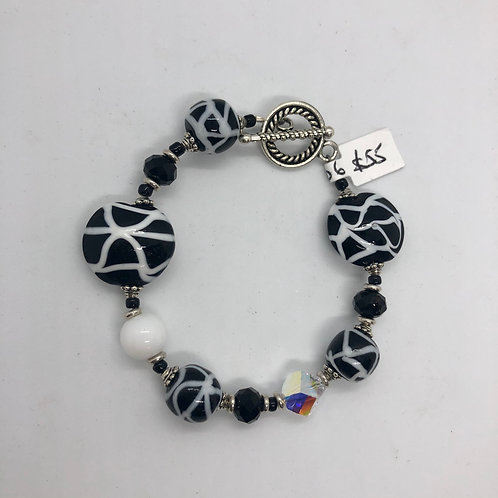 Black and white lentil-shaped lampwork beads with plated clasp #21