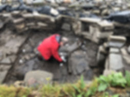 Dr Gerry McDonnell usinga portableXRF machine duringthe 2018 excavation of the Pictish smithy at Swandro