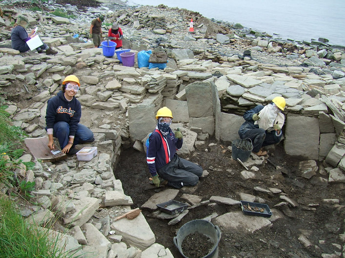 Excavating the Iron Age roundhouse at Swandro, Rousay, Orkney battling the midges