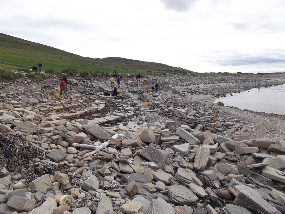 Lots & lots of boulder moving needed to uncover the site at Swandro