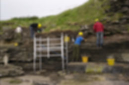 Cleaning and sampling of the erosion face of the broch at South Howe, Rousay