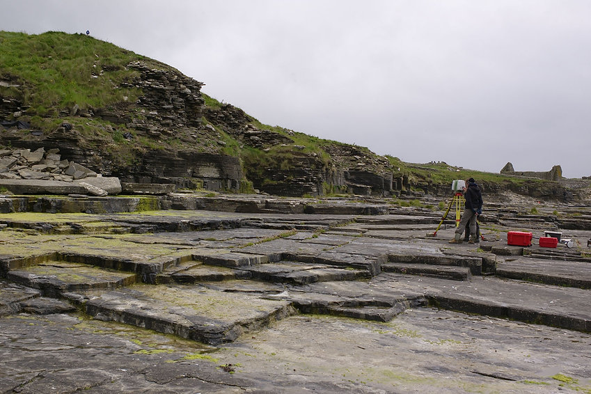 The eroding broch known as South Howe adjacent to Brough Farm in Rousay. Laser scanning taking place from the seaward side.