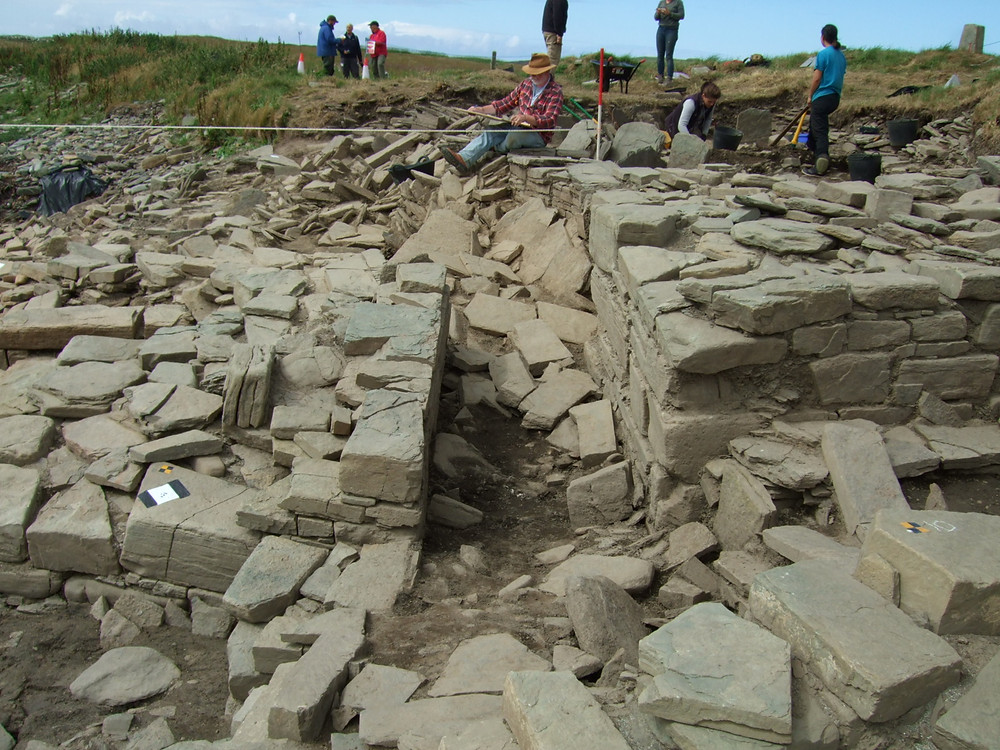 Looking down the entrance passageway of the chambered tomb at Swandro in 2018