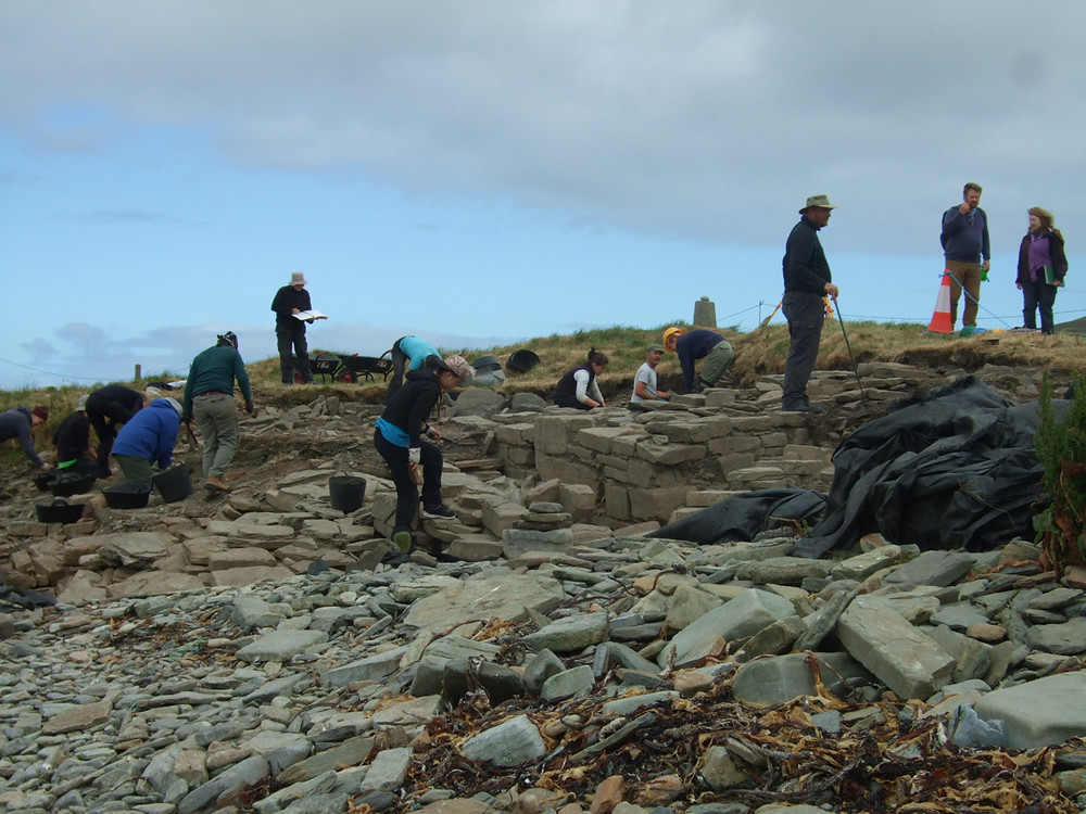 The chambered tomb appearing on the beach at Swandro