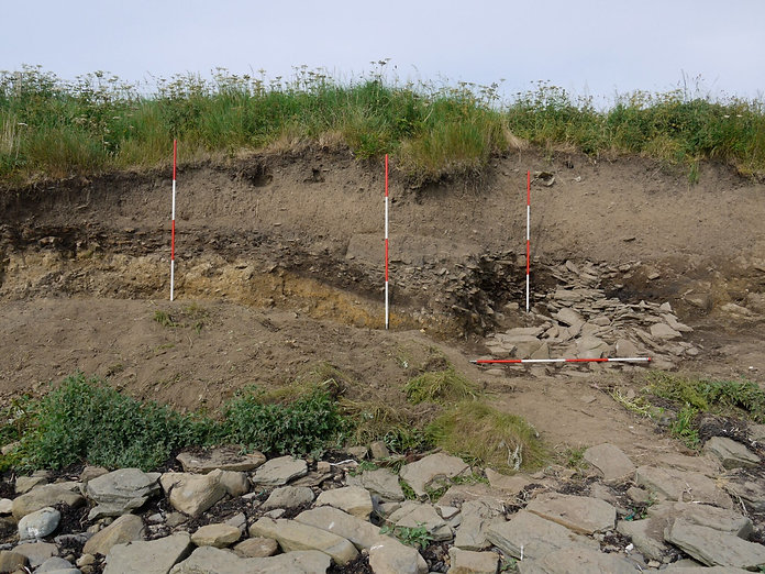 Coastal erosion of a burnt mound at Yorvlle in Rousay, Orkney
