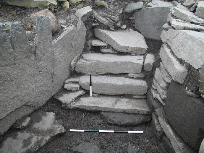 Steps leading into the Pictish Smithy at Swandro, Orkney