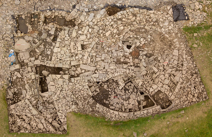 Drone photograph of the Late Bronze Age/Early Iron Age roundhouse and associated structures at the Knowe of Swandro, Rousay, Orkney.