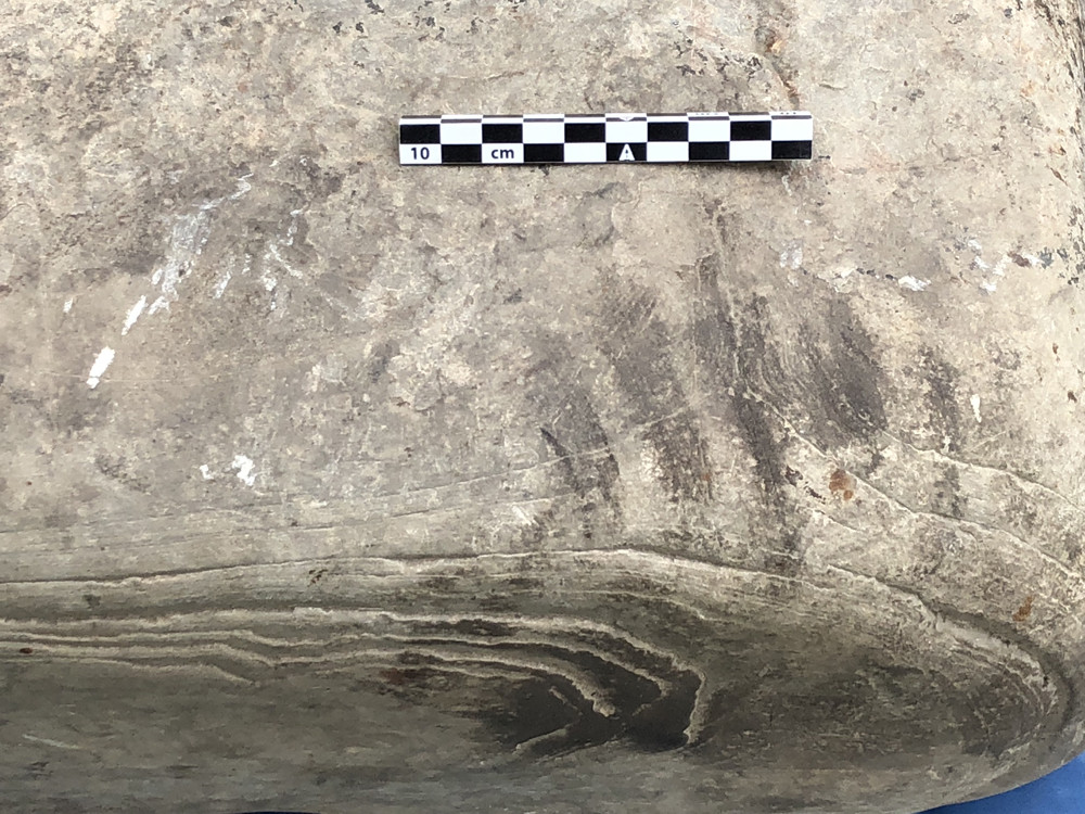 Knee marks on the Pictish anvil at Swandro, Orkney