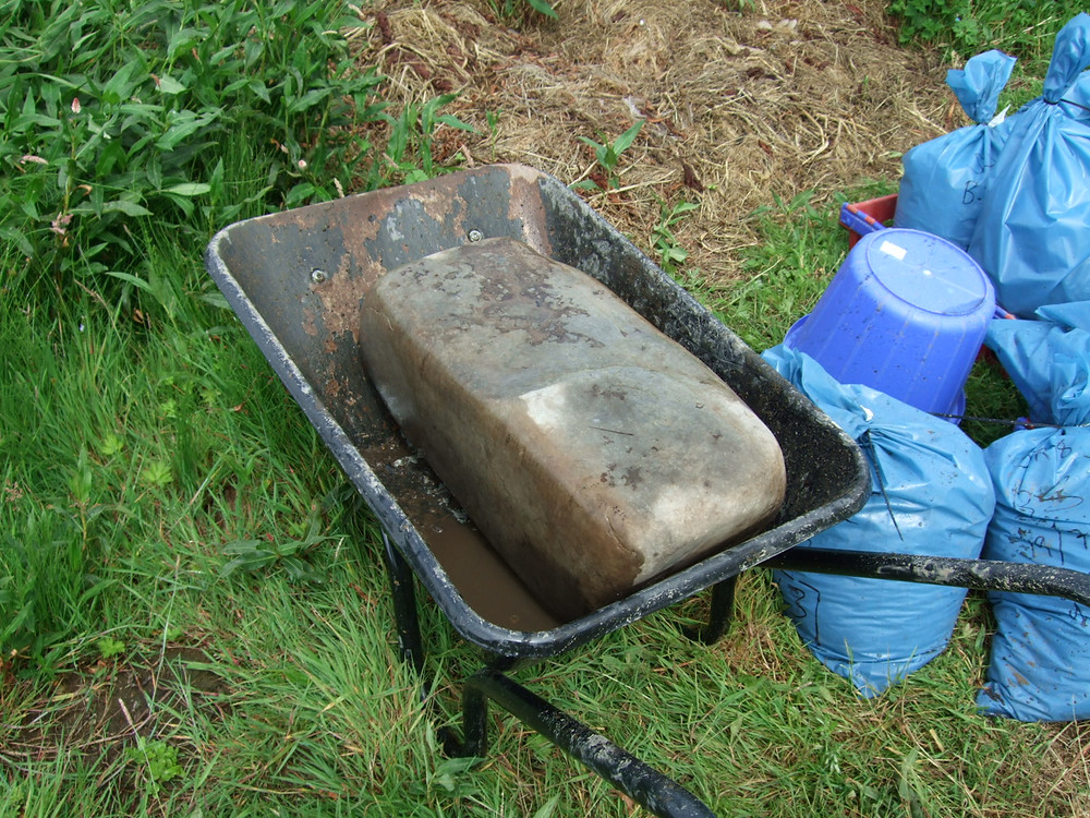 Pictish anvil coming off site in a wheelbarrow at swandro