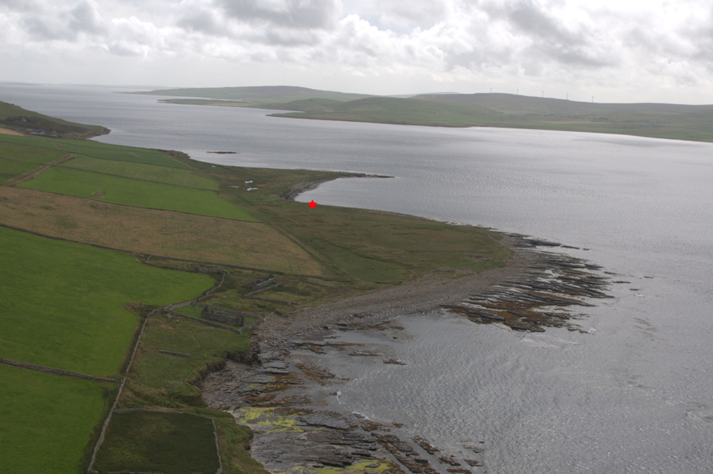 Looking south east down Eynhallow Sound with the Knowe of Swandro marked in red