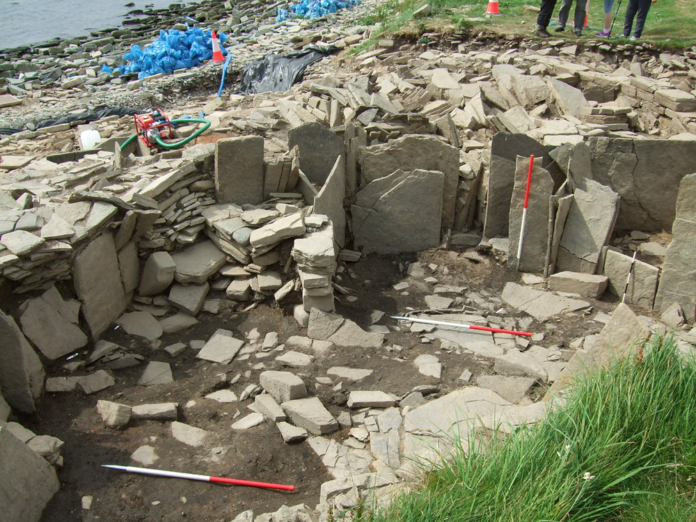 Orthostats subdividing the later remodelled phase of the Iron Age roundhouse at Swandro, Rousay, Orkney