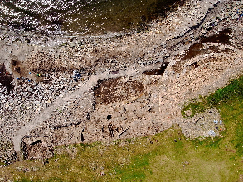 Aerial view of the Knowe of Swanro, showing the chamberd tomb to the right of the picture