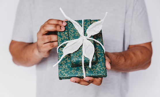 teal-gift-wrap-with-white-ribbon.jpg