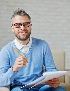 Male psychiatrist with pencil and clipbo