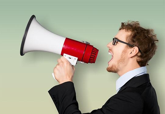 Man shouting into megaphone on copy.jpg