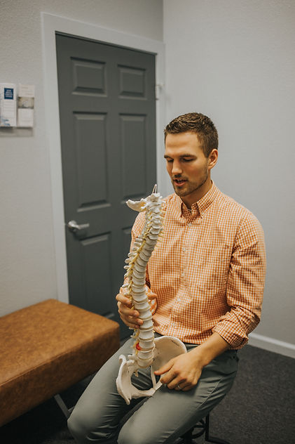 Gonstead Chiropractor holding spine teaching