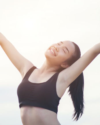 happy-smiling-athletic-woman-with-arms-o