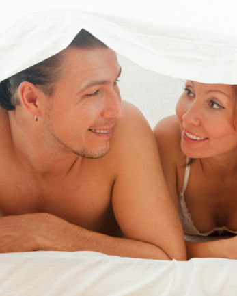 happy-couple-playing-bed_1398-4244.jpg