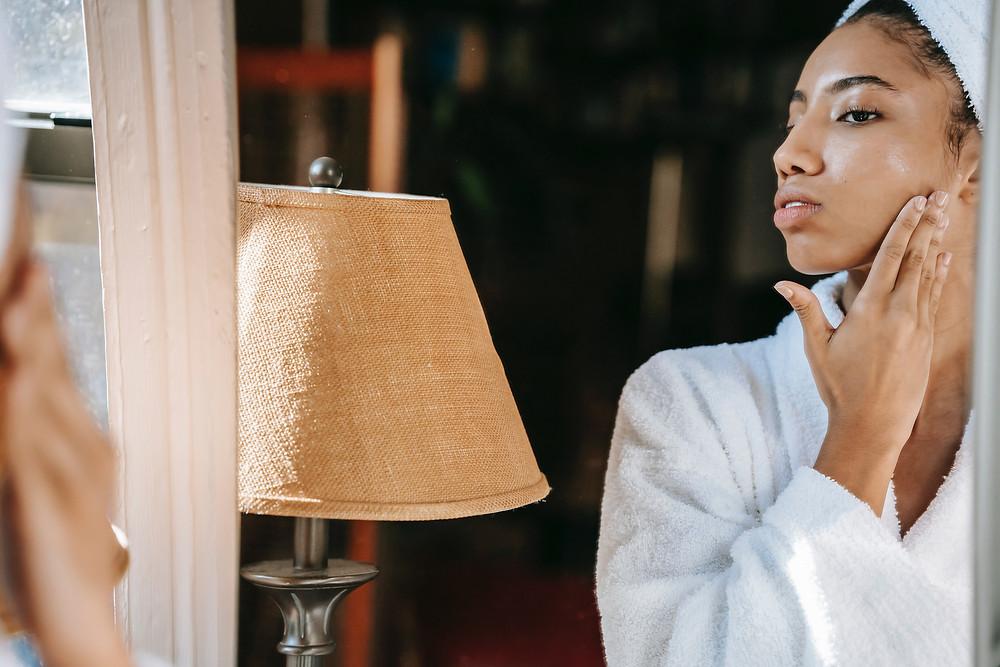Woman, skincare routine, serum, black skincare