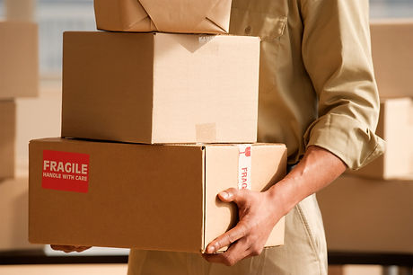 Delivery-Hands-Holding-boxes_edited.jpg