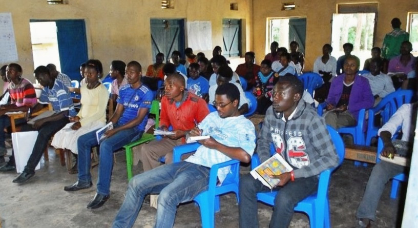 Youth attending a skills training workshop conducted by Mr. John Bosco,  (General Manager, Rukiga SACCO)  in 2016.