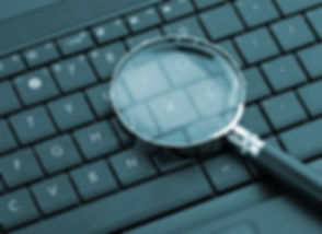 Magnifying glass on laptop computer.jpg