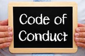 """""""Code of Conduct"""" writtn on small blackboard"""