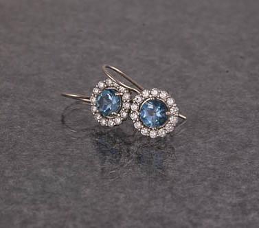 Aquamarine and diamond halo earrings