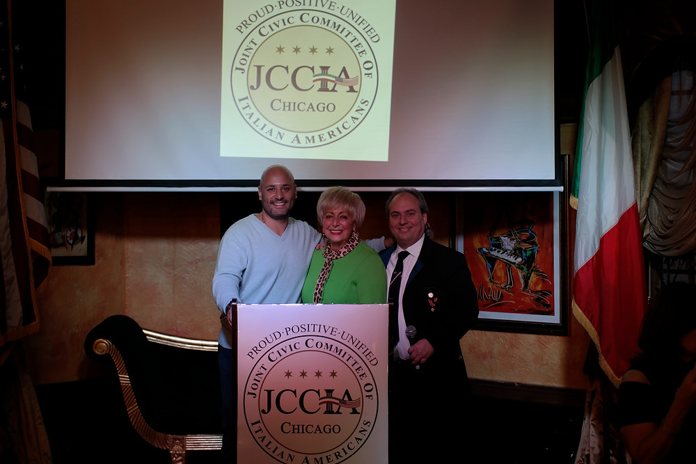 Jo Ann Serpico, Executive Director of the Joint Civic Committee of Italian Americans pictured with Past JCCIA President, Sergio Giangrande, and current President, Ron Onesti at the poidium.