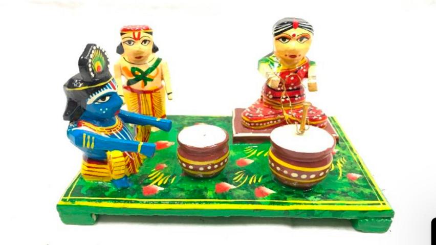Wooden Krishna making butter