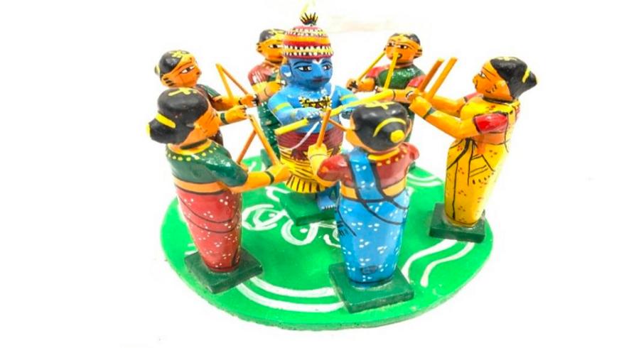 Wooden Krishna dancing