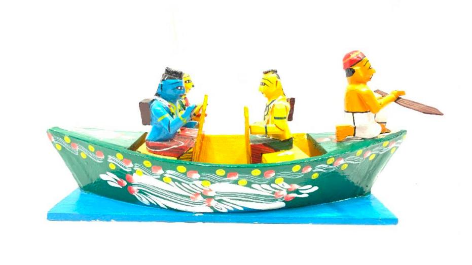 Wooden Krishna in a boat