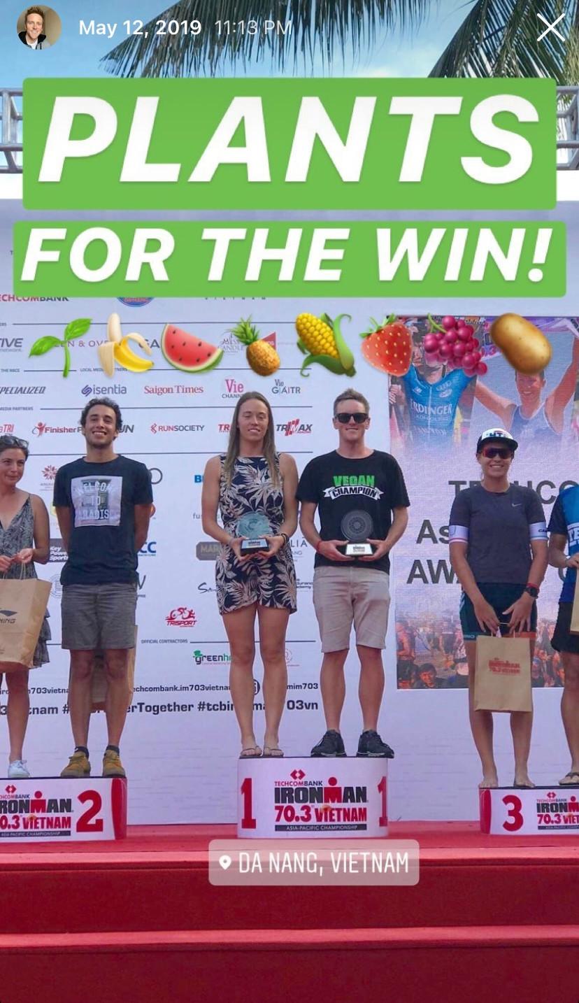 Jason Fonger vegan champion triathlete on the podium after Ironman 70.3 Vietnam 2019 Asia-Pacific Championships