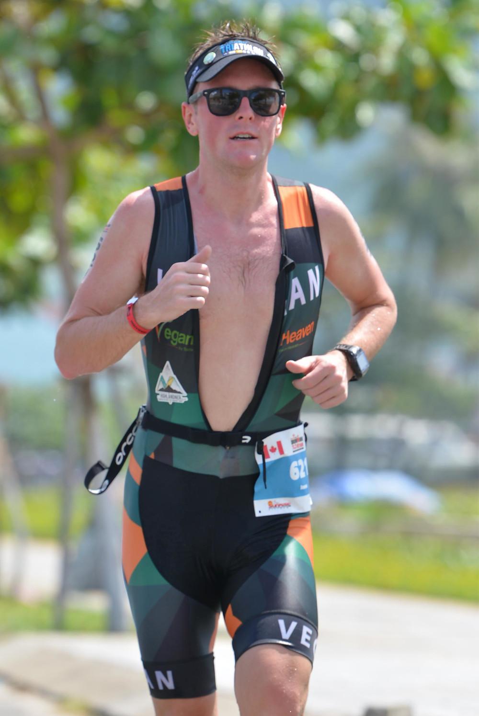 Jason Fonger vegan champion triathlete running at Ironman 70.3 Vietnam 2019