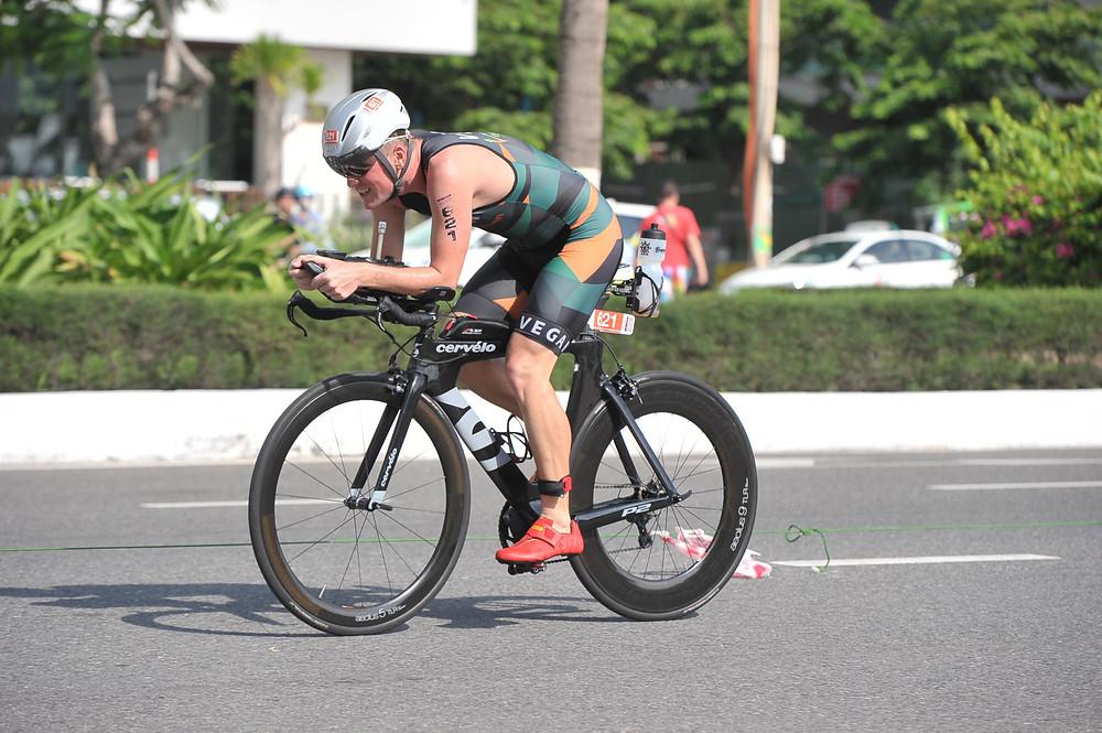 Jason Fonger vegan champion triathlete cycling at Ironman 70.3 Vietnam 2019