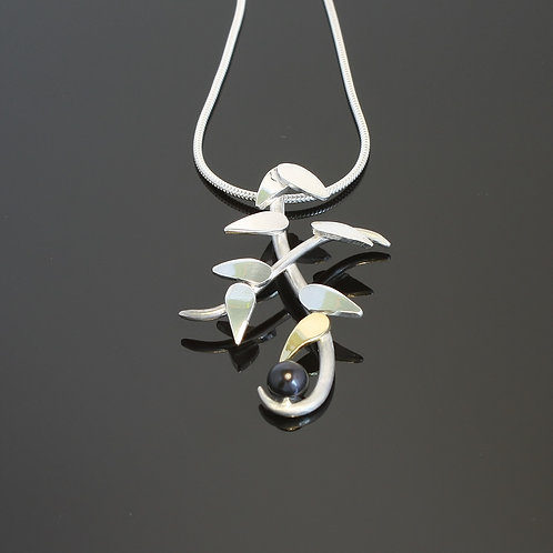 """Sun"" and pearl pendant £270"